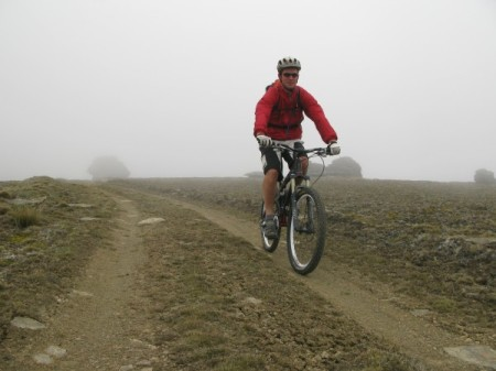 Tony riding through the mist